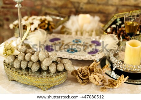 A chest with a sparkling grape on the top stands on the table with decor - stock photo