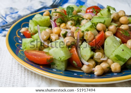 A Chickpea (Garbanzo Bean) Salad on a plate - stock photo