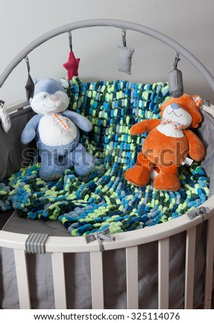 a child bed with two teddy bear - stock photo