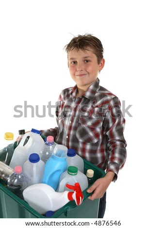A child carrying a plastic container full with empty recyclable household material. - stock photo