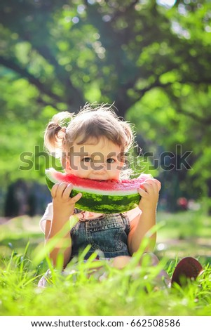 A child eats watermelon. Selective focus.