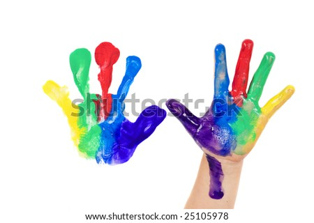A child having fun painting hands in bright colors