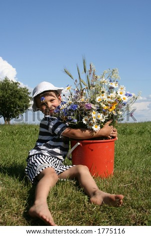 A child holding a bouquet of flowers - stock photo