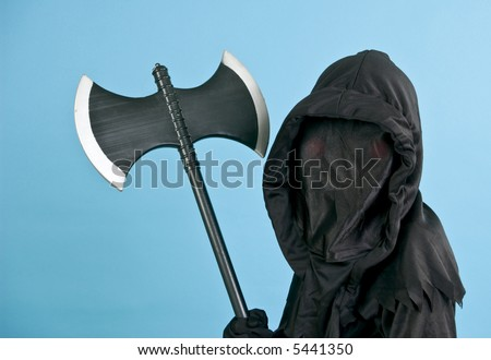 A child in a spooky black costume holding a medieval axe. (horizontal shot)