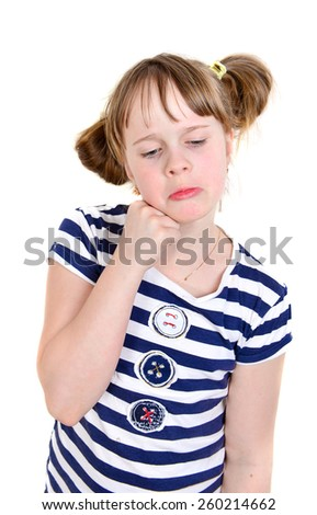 A child looks sad while, tired an checks her forehead for fever or tooth pain.   - stock photo