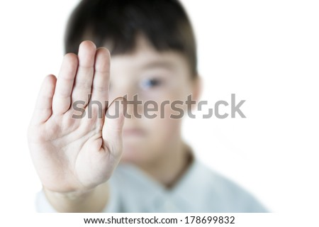 A child making s stop gesture with his hand - stock photo