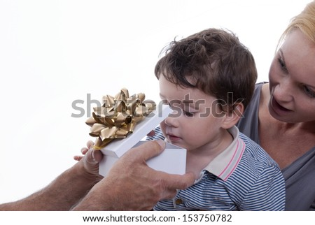 A Child Opening Surprised a Gift Box in the Arms of His Mother, Isolated - stock photo