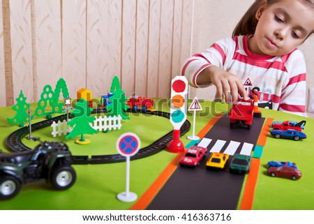 A child plays in the automotive and railway. - stock photo