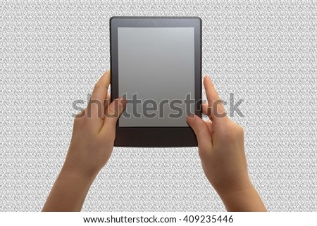 a child read an e book in a grey texture