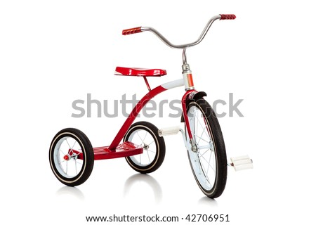 A child's red tricycle on a white background - stock photo