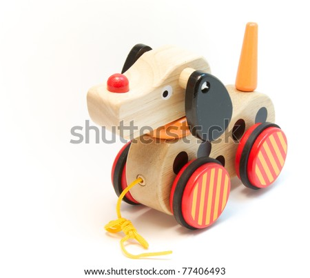 A child's wooden toy dog - stock photo