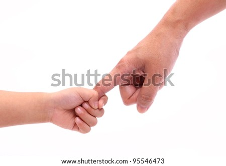 A child shakes hand with mother.
