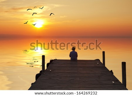 a child thinking in solitude - stock photo