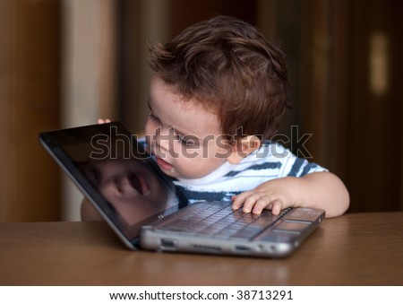 A child using computer as a mirror