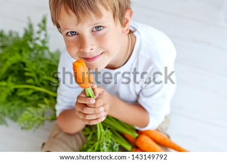 A child with a vegetable