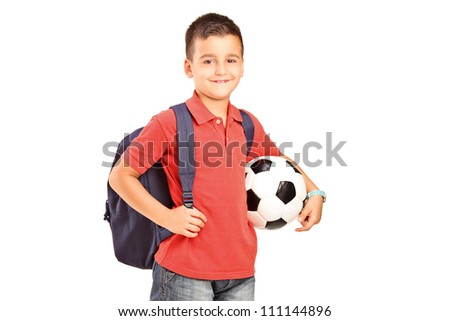 A child with backpack holding a soccer ball isolated on white background