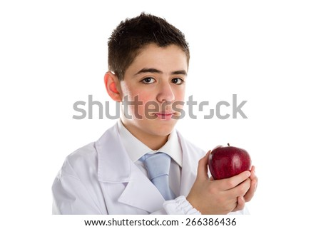 A child with medical white coat is showing a juicy and tasty red apple reminding of an old saying, An apple a day keeps the doctor away, that is the importance of a healthy diet. no photo retouching.