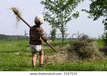 A child working in a village - stock photo