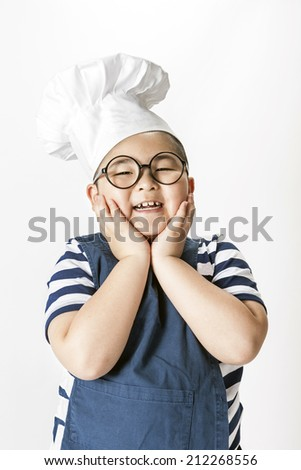 A children chef wearing blue apron in the white background. - stock photo
