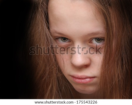 A chilling portrait of a vulnerable young girl - stock photo