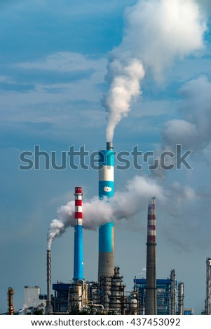 A chimney chemical plant in the discharge of pollutants - stock photo