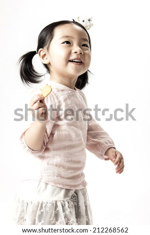 A chinese girl running and holding cookies in the white background.