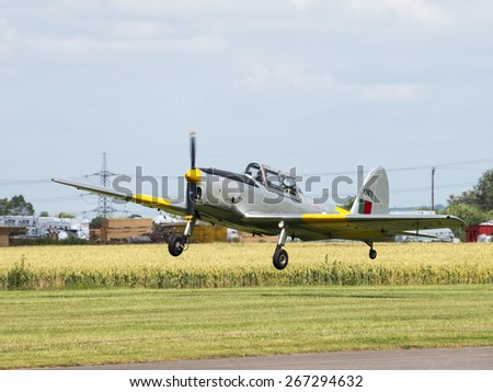 A Chipmunk classic 1930s aicraft lands at Breighton airfield,Yorkshire,UK.taken 14/07/2013 - stock photo