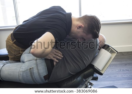 A Chiropractor male exercising therapy at office - stock photo
