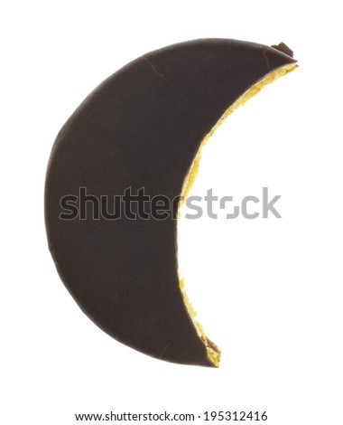 A chocolate pie dessert in the shape of a crescent moon on a white background. - stock photo