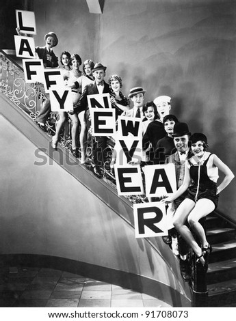 A chorus line standing on a curved stair case - stock photo