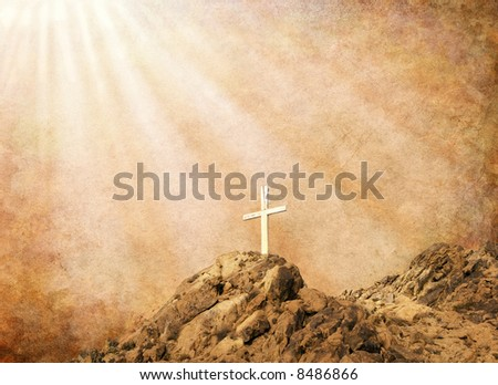 A Christian cross with spiritual light and sepia textures. - stock photo