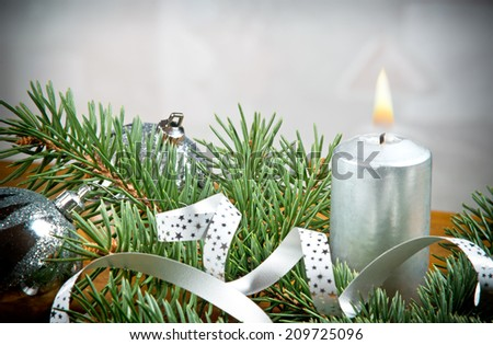 a Christmas candle with silver background - stock photo