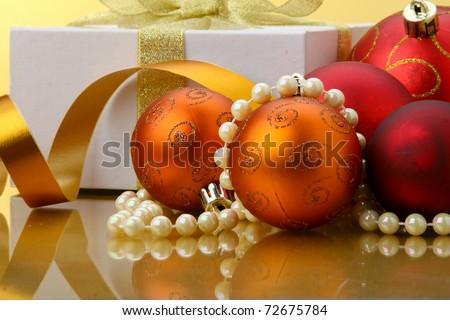 a Christmas gift box with christmas balls - stock photo