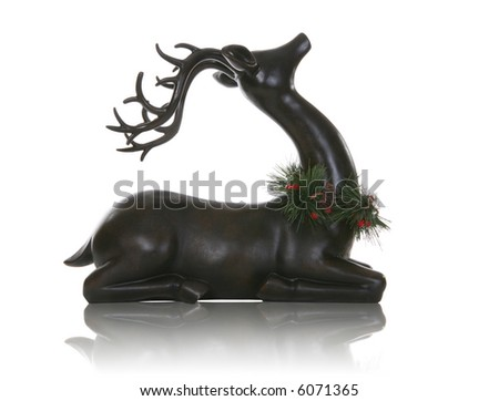 A Christmas  reindeer resting over a white background - stock photo