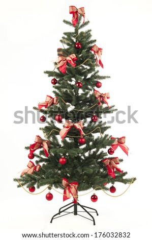 A Christmas tree is decorated with red ornaments and bows.