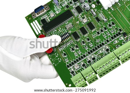 A circuit board hand held with white gloved hand isolated on white