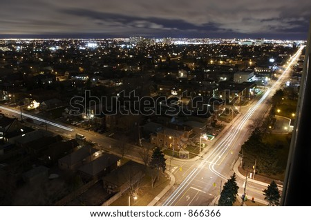 A city at night from above. Intersection. - stock photo