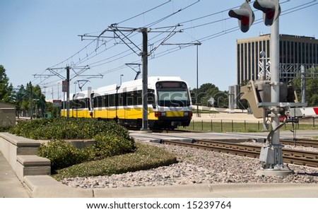 A city rapid transit system traveling down the rail towards the station. - stock photo