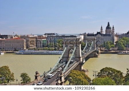 A city view of a Chain bridge and St. Stephen's church in Budapest, Hungary