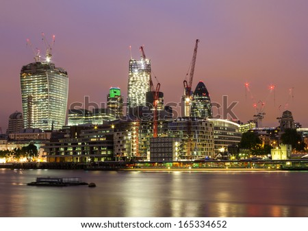 A cityscape of the City of London at night - stock photo