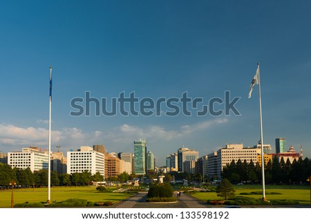 A cityscape of the Yeouido Dong district and its office buildings seen from the top steps of the National Assembly building in Seoul, South Korea - stock photo