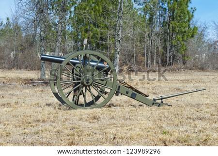 A civil war era cannon on the battlefield. - stock photo