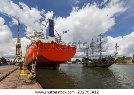 A civilian ship and the pirate ship - stock photo