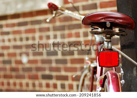 A Classic Bicycle is Locked Up Against a Brick Wall on State Street in Madison - stock photo