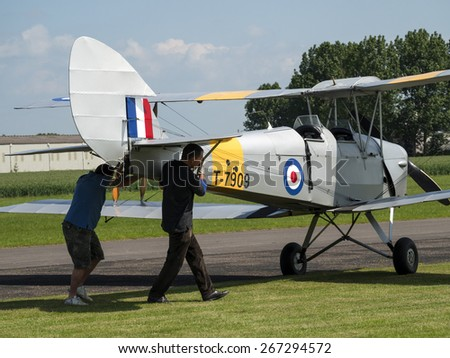 a classic British Tiger Moth 1930s biplane at Breighton airfield,yorkshire,UK.taken 14/07/2013 - stock photo