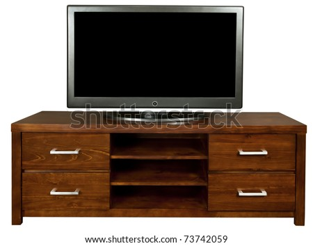 A classic brown wooden TV cabinet with a large LCD TV on it. - stock photo
