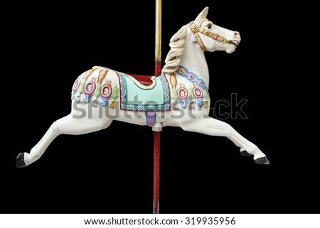 A classic carousel horse on black. Clipping path included. - stock photo