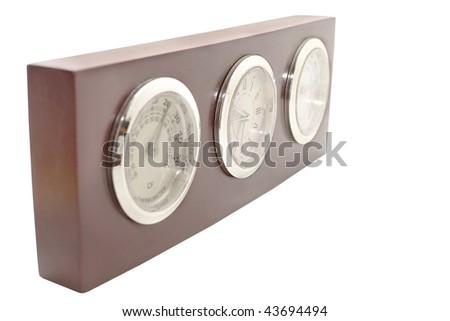 A classic clock face with a thermometer and a hygrometer. - stock photo