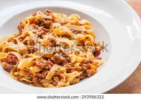 A classic traditional Italian dish, ragu all bolognese, with tagliatelle in a white bowl - stock photo