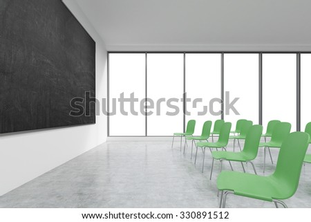 A classroom or presentation room in a modern university or fancy office. Green chairs, panoramic windows with white copy space and a black chalkboard on the wall. 3D rendering.